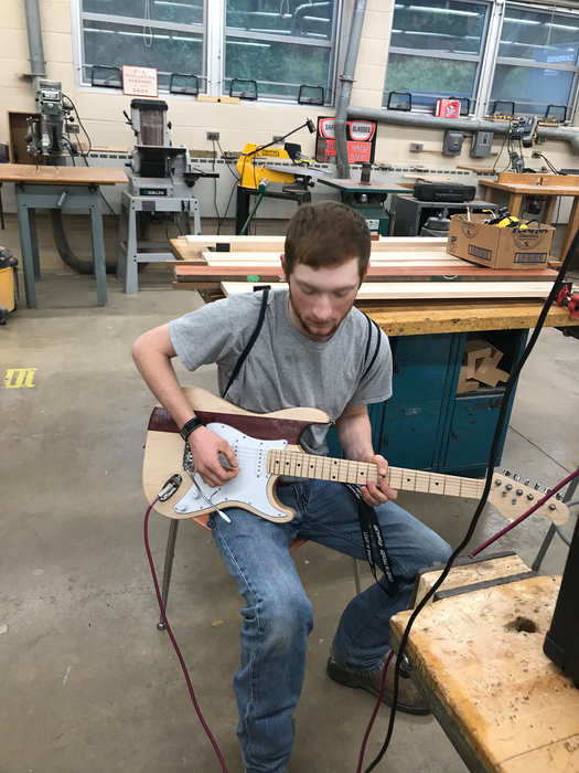 Talented!  Indy hand crafted this guitar!